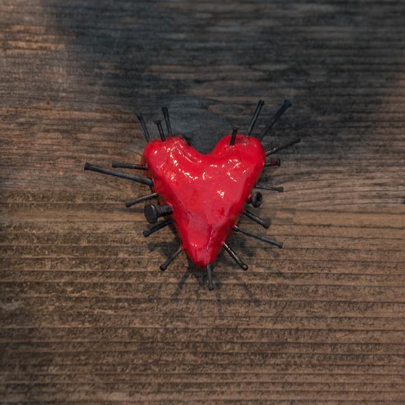 Heart nailed on a board